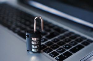 This picture show a lock on top of a laptop.