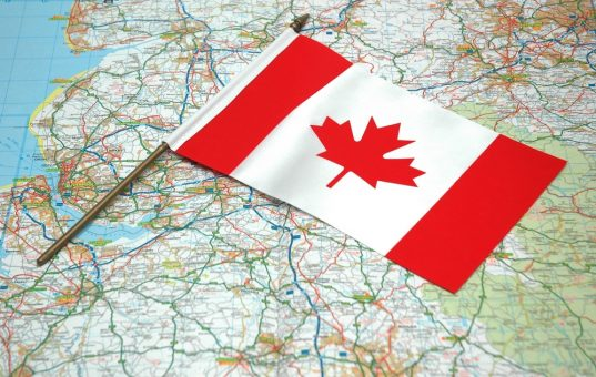 Flag of Canada over the map