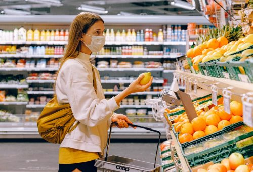 This picture show a person buying some fruits.